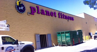 Planet Fitness wall sign